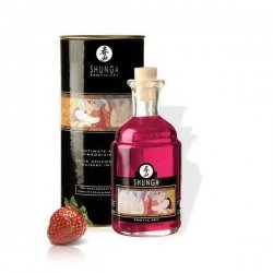 Aphrodisiac oil kissing intimate of strawberries with champagne